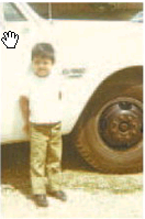 Javier Hernández next to his father's truck